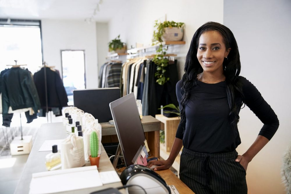 woman in brick and mortar retail store smiling