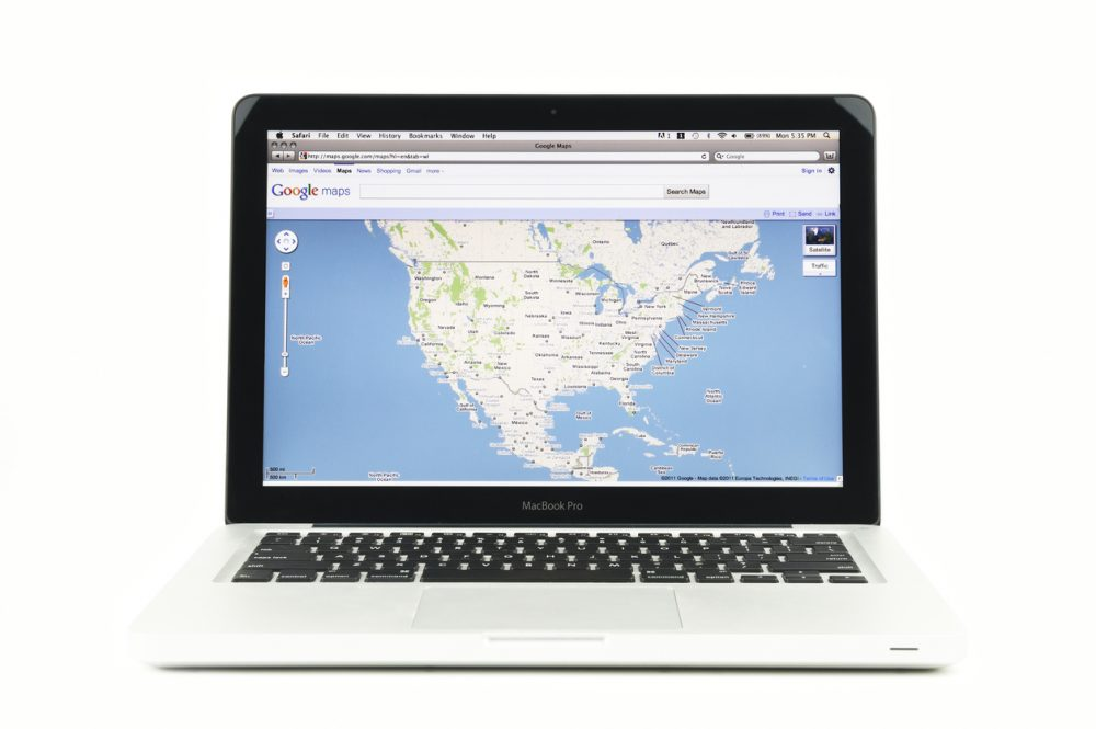"Google Maps displayed on a 13"""" Macbook Pro laptop, placed on a white background."""